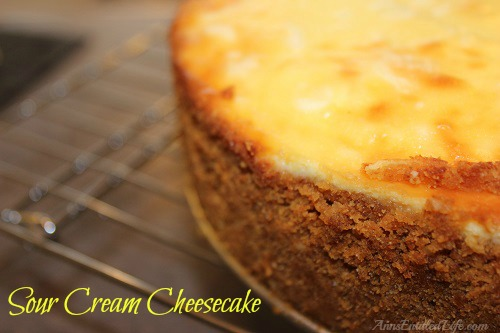 Sour Cream Cheesecake Recipe. This Sour Cream Cheesecake Recipe is creamy and delicious. Easy to make, your guests and family will love every tangy-sweet bite!