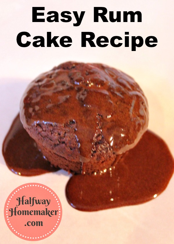 a rum baked cupcake covered in chocolate sauce on a plain counter
