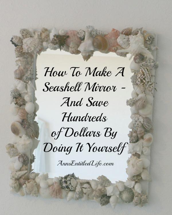 Handmade vertical seashell mirror hanging on a wall