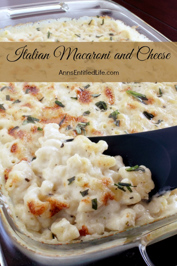A pan of baked Italian style macaroni and cheese, a serving spoon is lifting out a portion directly from  the pan