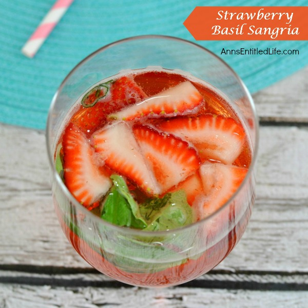 Strawberry Basil Sangria. A fun and delicious strawberry sangria recipe! Great for a sweet dinner drink, party libation or anytime cocktail, this Strawberry Basil Sangria is a perfect weekend beverage for adults.
