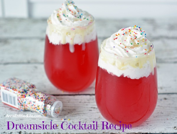 Dreamsicle Cocktail Recipe. A fruity, fun, and fabulous cocktail, this dreamsicle drink recipe will remind you of that delicious effervescent fruit punch you loved as a kid. Sweet and creamy, this terrific dreamsicle is made with vodka and soda pop, and is super simple to make. This is a great party, pool, or summer BBQ drink.