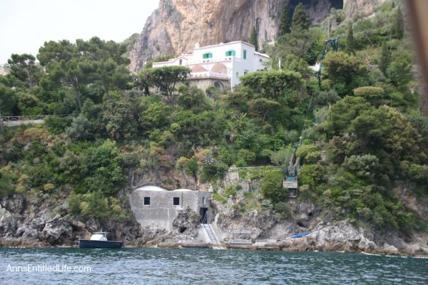 The Amalfi Coast, Italy; The Amalfi Coast is a stretch of coastline on the southern coast of the Sorrentine Peninsula in the Province of Salerno in Southern Italy. Known for hosting the rich and famous, Amalfi is beautiful, fairly isolated, and crowded!