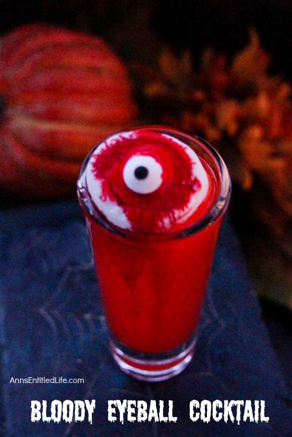 Bloody Eyeball Cocktail Recipe; This delightfully eerie cocktail is a fun one to serve at a Halloween or Monster costume party. While ghoulishly frightening, it is actually sweetly delicious! Sure to be the most talked about drink at your next fiendish get together.