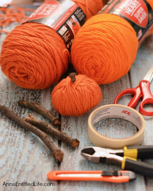 Easy DIY No-Sew Yarn Pumpkins; these No-Sew Yarn Wrapped Pumpkins are super easy to make, require no special crafting skills and are totally adorable. If you need a quick fall craft, or would like a (supervised) project for your children on a rainy weekend, these pumpkins are a terrific craft project.