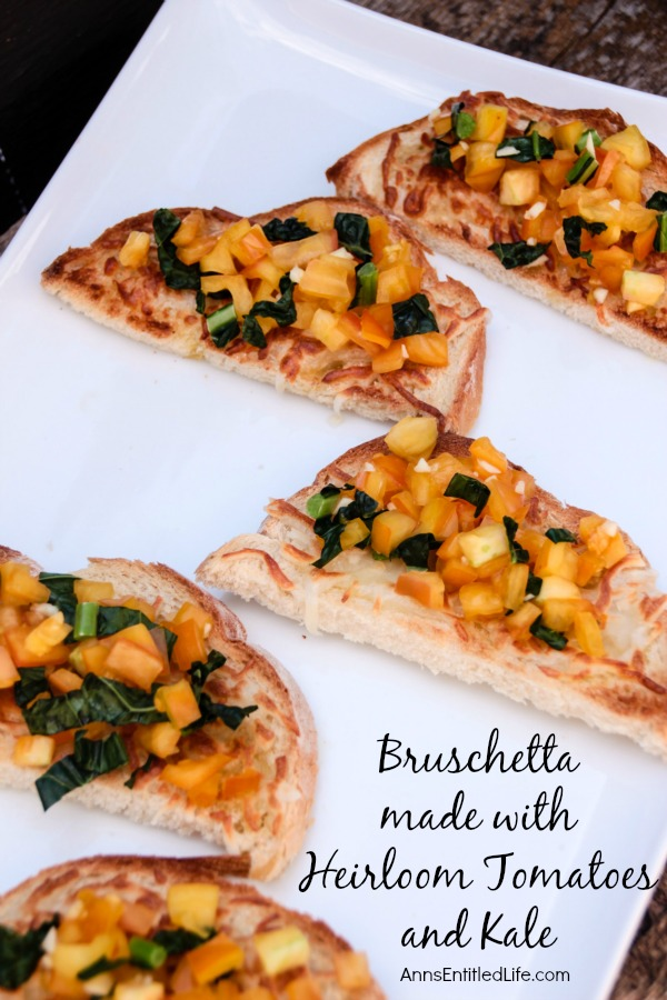 Bruschetta made with Heirloom Tomatoes and Kale; a delicious, easy to make Bruschetta recipe featuring delicious and sweet heirloom tomatoes, and tasty kale. This very versatile  Bruschetta made with Heirloom Tomatoes and Kale is a perfect accompaniment with any meal, a before meal appetizer, or simply as a stand alone snack.