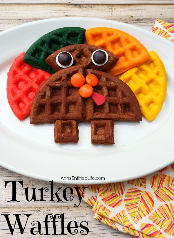 colored waffle in the shape of a turkey on a white plate