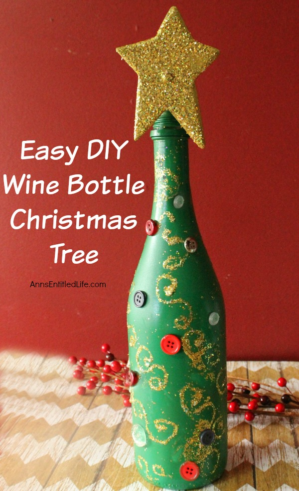 Easy DIY Wine Bottle Christmas Tree. An empty wine bottle, some glitter, paint and glue combined with a little imagination easily transforms into a pretty holiday decoration! Upcycle your empty wine bottles to make a lovely Christmas Tree decoration. Make one or make a grouping to form a centerpiece, mantel decoration, or unique side table decor.