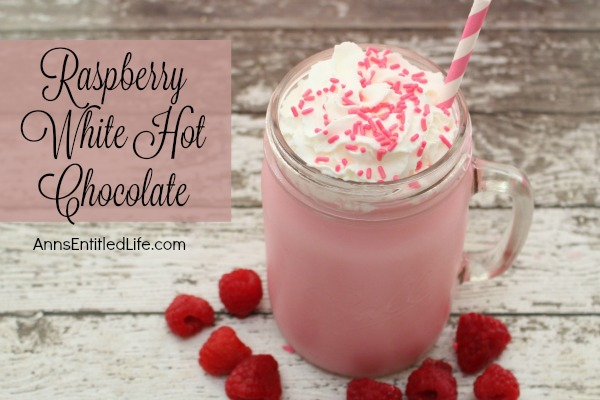 Raspberry White Hot Chocolate Recipe. Snuggle up this winter with a cup of Raspberry White Hot Chocolate  made from scratch. A delicious update to traditional hot chocolate, this yummy mixture will warm you up inside.