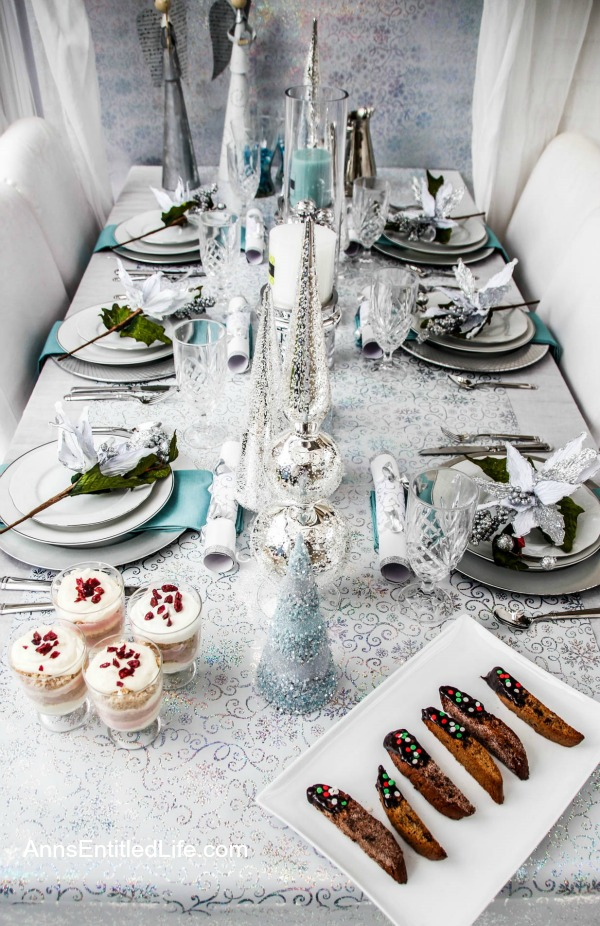 Winter Holiday Tablescape: White, Silver and Blue. Hosting a holiday party? Dressing up the table for Christmas, New Year's or just because? Break away from the traditional green and red Christmas colors and try something entirely different. This beautiful winter holiday tablescape features white, silver and blue. A lovely cool theme to compliment the winter landscape.