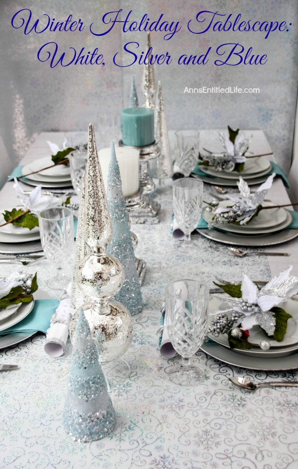 Winter holiday tablescape white silver and blue Christmas table dressing