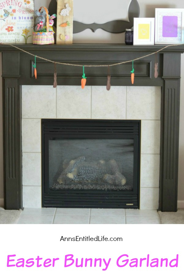 a garland made of stuffed bunnies and carrots hanging by a fireplace