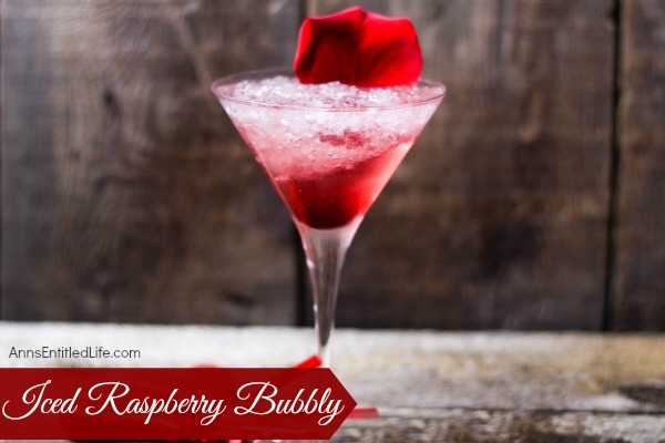Iced Raspberry Bubbly Recipe. A beautiful update on a classic drink, this Iced Raspberry Bubbly Recipe combines the subtle taste of hibiscus with the bold taste of raspberry and mint for a truly delicious cocktail.