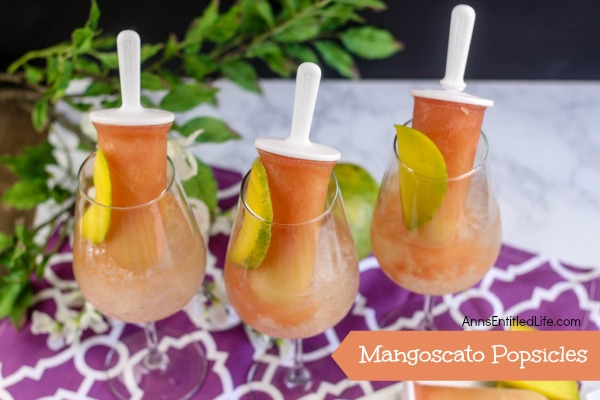 Mangoscato Popsicles Recipe. A delicious, cool and fun ice pop dessert and libation in one. These Mangoscato Popsicles are a special sweet and tasty treat for adults on a hot summer day!