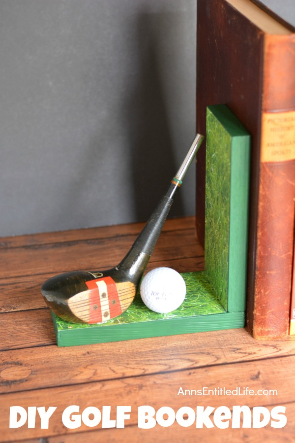 Left side of handmade bookends with golf club decor. There are several books in between the book ends. This is set upon a mantel, against a grey wall background.