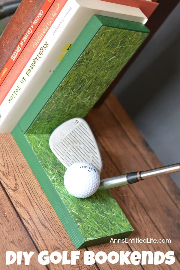 Ridht side of handmade bookends with golf club decor. There are several books in between the book ends. This is set upon a mantel, against a grey wall background.
