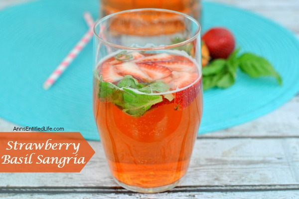 Strawberry Basil Sangria. A fun and delicious strawberry sangria! Great for a sweet dinner drink, party libation or anytime cocktail!