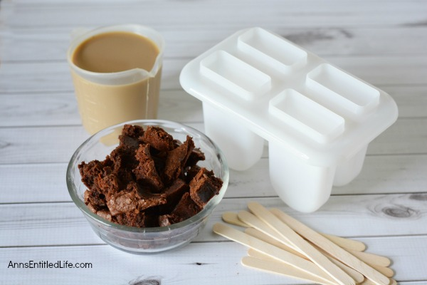 Brownie Mocha Popsicles Recipe. The delicious taste of coffee combined with fantastic, chewy and decadent brownies make for a heavenly frozen confection. Make your own popsicles with this easy Brownie Mocha popsicles Recipe for a delicious frozen treat.