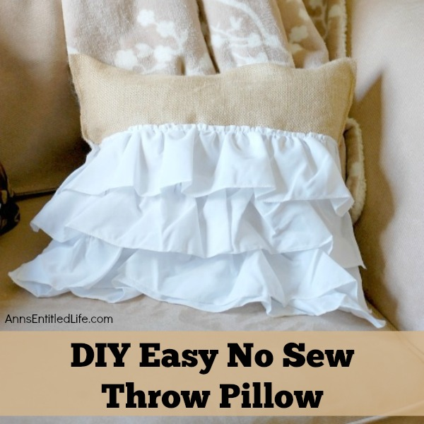 DIY Easy No Sew Throw Pillow. Make this easy, no sew throw pillow for a quick decor update. This step by step tutorial will teach you how to make this no sew ruffle burlap pillow in a short time. Simple to make, this ruffled burlap pillow is adorable for bed decor, family room decor or even casual living room decor!