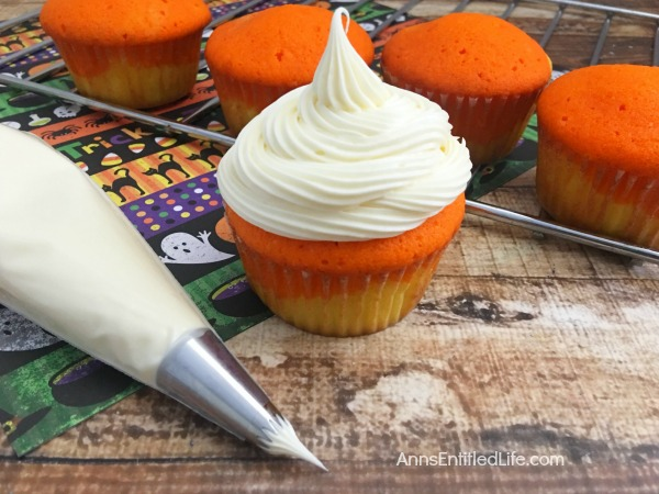 Candy Corn Cupcakes Recipe. A fall favorite, these delicious, easy to make sweet cupcake treats are perfect for snack-time, lunch-time, anytime! Get into the spirit of Autumn with these adorable Candy Corn Cupcakes.