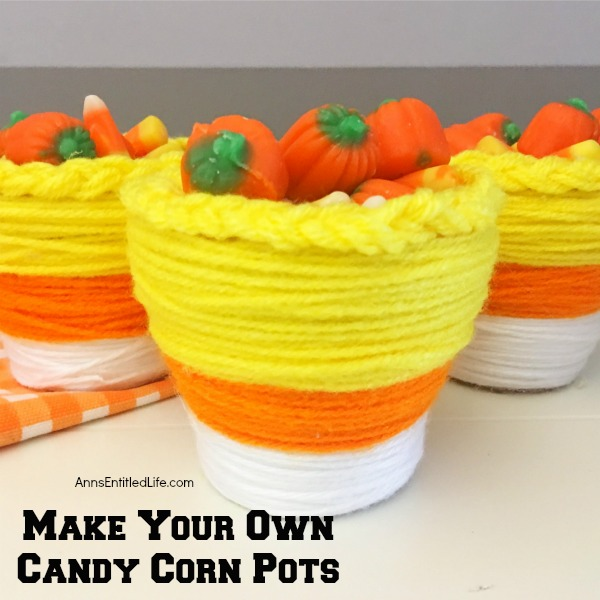 DIY Candy Corn Pots. These DIY Candy Corn Pots are simple to make. Dress up your pots for autumn or Halloween with this sweet candy corn decoration. Perfect for planting herbs in the fall for your kitchen window, or to hold candy corn candy, Halloween treats or nuts on a sideboard, mantel or end table, these do it yourself candy corn posts are a nice touch of whimsical fall décor.