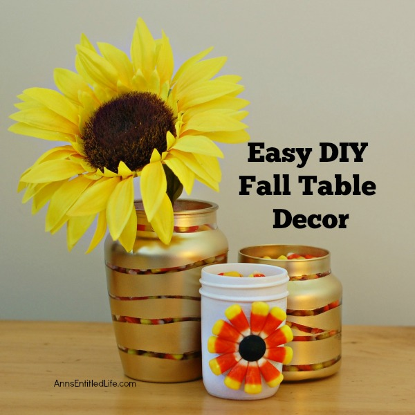 Easy DIY Fall Table Decor. Seasonal decor does not need to be expensive or time consuming to achieve. This easy to make, do it yourself autumn table decor features mason jars, vases and sunflowers which comes together quickly, is highly customizable and simple to make. Just perfect for the fall months!