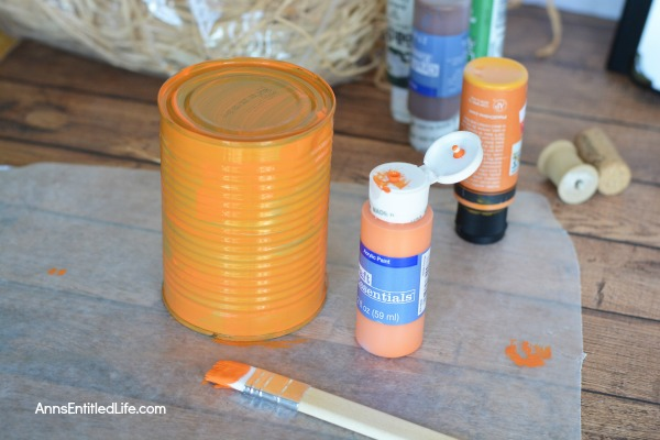 Tin Can Pumpkins Craft. A cute way to upcycle your soup, vegetable and fruit cans into a darling autumn craft. This Tin Can Pumpkins Craft is a variation of the tin can painting that we all learned in grade school. This is a simple craft that is easy enough for a child to make with some adult supervision.