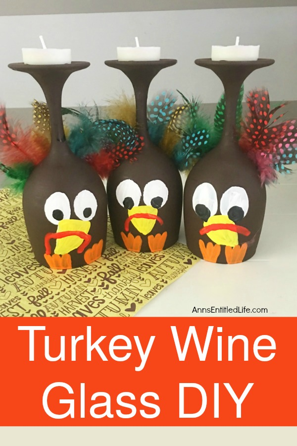 Three wine glasses in a row that are painted to look like turkeys sitting on top of a Thanksgiving-themed paper.