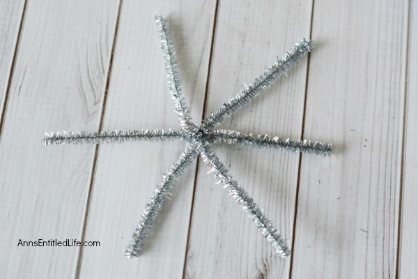 Easy DIY Button Snowflake Ornament. An Easy DIY Button Snowflake Ornament craft anyone can make. This is a simple Christmas tree ornament to add to your handmade collection.