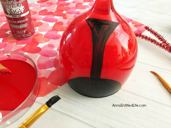 Love Bug Wineglass DIY. Make your own adorable Love Bug Wineglass. This easy step by step tutorial will show you how to easily make a wine glass love bug which is perfect for a centerpiece, mantel decor or table decorations this Valentine's Day, or for a wonderful spring or summer craft! If you are looking for an adorable craft project, this is it!