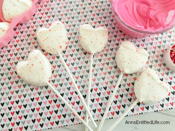 Easy Heart Peeps Pops Recipe. Dress up marshmallow Peeps hearts with holiday sprinkles and chocolate! These simple to make Peeps pops will be a big hit with friends and family this Valentine's Day. If you are looking for a simple to make Valentine Day candy treat, this is it.
