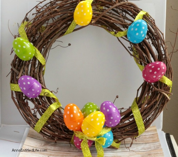 DIY Easter Egg Wreath. This Easter egg grapevine wreath is a wonderful spring door craft. This cute, simple to make, Easter egg wreath is an inexpensive Easter decoration, perfect decor for your door, over your fireplace or on a wall.