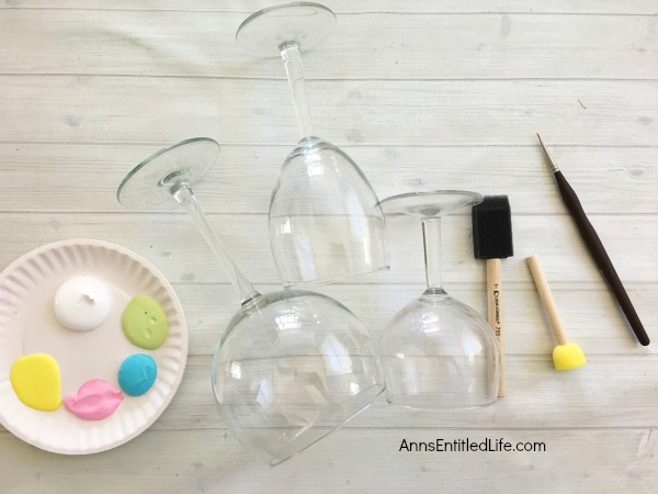 Easter Egg Wineglass DIY. Make your own adorable Easter egg wineglasses! This easy step by step tutorial will show you how to easily make sweet Easter egg wineglass decor which are perfect for a centerpiece, mantel decor or table decorations this Easter! This is an easy to make, delightful Easter season craft project.