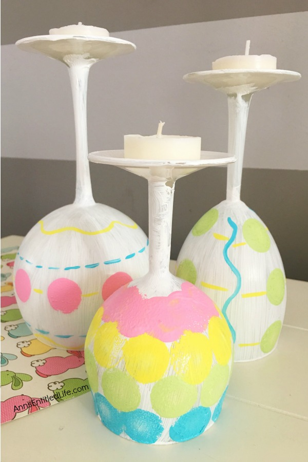 Easter Egg Wine Glass DIY. Make your own adorable Easter egg wine glasses! This easy step-by-step tutorial will show you how to easily make sweet Easter egg wine glass decor which is perfect for a centerpiece, mantel decor, or table decorations this Easter! This is an easy-to-make, delightful Easter season craft project.