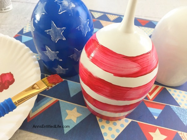 Flag Wineglass DIY. Make your own unique patriotic flag wineglasses! This easy step by step tutorial will show you how to easily make flag wineglass decor which are perfect for a centerpiece, mantel decor or table decorations. This is an easy to make craft project.