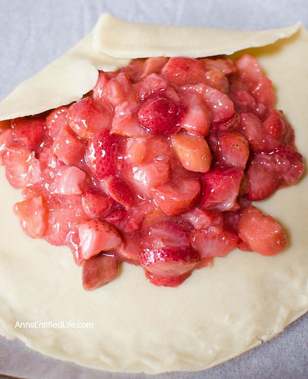 Strawberry Rhubarb Galette Recipe. Using fresh (or frozen) fruit, this pretty galette dessert is easy to make, but impressive to serve - not to mention super tasty! Make it for a treat tonight!
