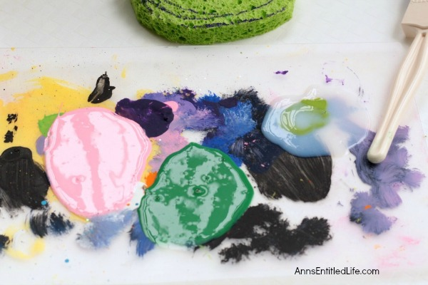 Watermelon Painted Napkins Craft. An easy, fun craft to make your own watermelon napkins using a sponge and acrylic paint! If you are looking for a fun summer napkin, a housewarming gift or shower present made with your own hands, this is it!