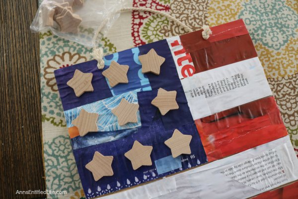 This DIY Decoupage American Flag Sign can be hung on your front door or inside your home or displayed on your patio for Independence Day - or anytime really since it is an