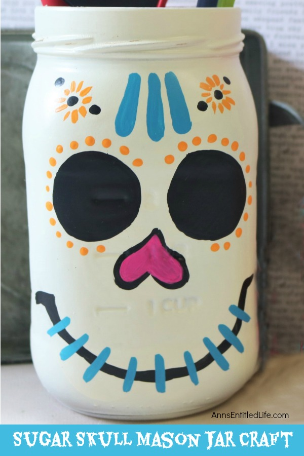 Sugar Skull Mason Jar Craft. This easy to make sugar skull is fashioned from an old Mason jar.  You can store kitchen utensils, candy (keep the lid!), etc in these jars for Halloween or to celebrate the Day of the Dead. Using old glass jars is a great way to get crafty at home and make your own cute décor at the same time.