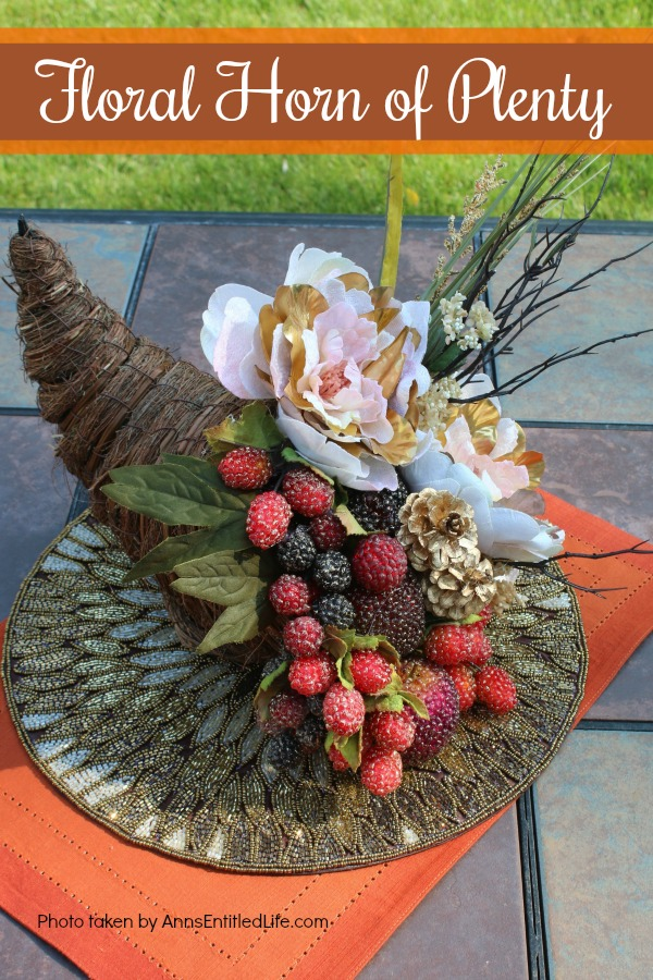 Floral Horn of Plenty DIY. This beautiful floral horn of plenty is a wonderful centerpiece or end table decorative piece, perfect for the fall season. A lovely Thanksgiving decor accessory, this overflowing cornucopia is easy to make, and highly customizable.