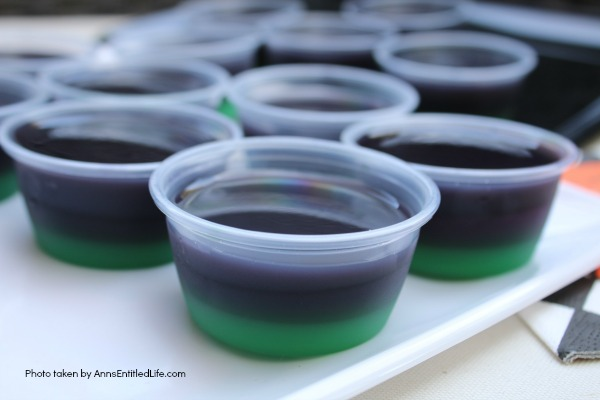 Purple People Eater Jello Shots Recipe. This Purple People Eater Jello Shot recipe is a taste of Halloween in a party shot! Simple to make, these Purple People Eater Jello Shots are great for parties, tailgating, and more!