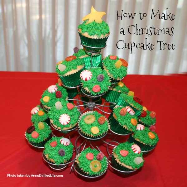 How to Make a Christmas Cupcake Tree. This simple step by step tutorial will help you put together this wonderful Christmas cupcake display. Great as a holiday party dessert display, for a centerpiece at the children's table, or for a Christmas buffet, this Christmas cupcake display is easy to put together and oh so cute!