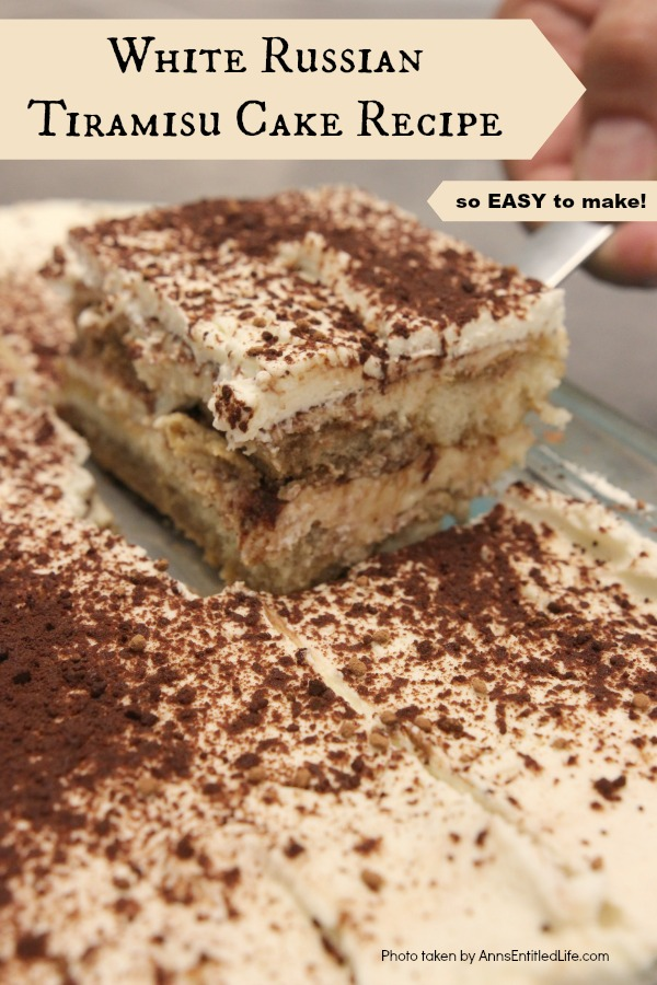 An upclose photo of a piece of white Russian tiramisu being lifted from the cake pan.