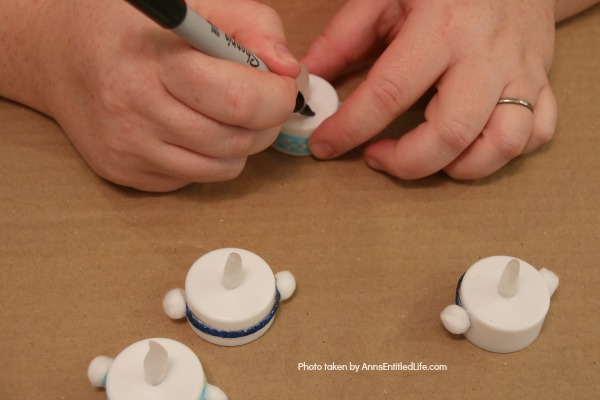Easy Snowman Tealights Craft. These cute little snowman tealights are simple to make, and wonderful decor for the winter months. This 15-minute-craft is simple to make, and come together quickly!