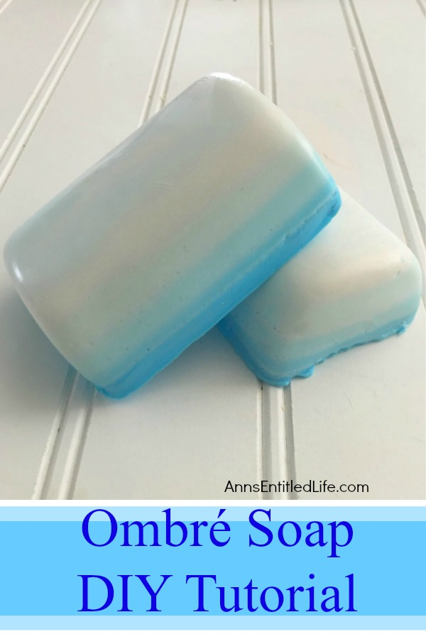 homemade soap in graduated colors on a beadboard background
