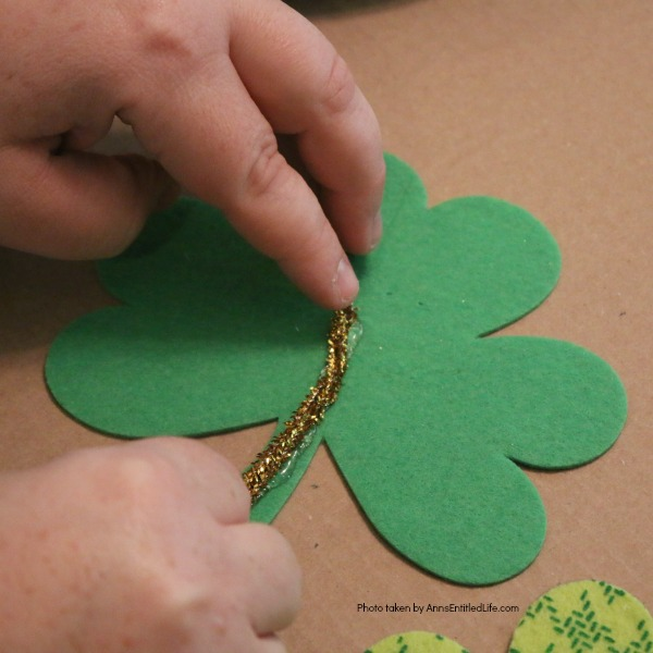 St. Patrick's Day Door Hanger DIY. Make your own St. Patty's Day door décor! This leprechaun inspired, easy DIY tutorial comes together quickly when you follow these step by step craft instructions. This St. Patrick's Day Door Hanger DIY project is simply adorable!