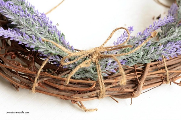 Simple Lavender Grapevine Wreath DIY. Encourage peace and relaxation in your home by making and using this scented lavender wreath. Easy to make, this simple lavender grapevine wreath comes together in about 15 minutes.
