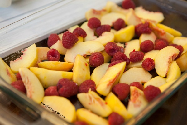 Raspberry Peach Cobbler Recipe. The sweet taste of plump, juicy peaches and the tart taste of raspberries combine for a lovely cobbler that will have your whole family asking for seconds.  Give this old-fashioned, easy to make raspberry peach cobbler a recipe tonight!