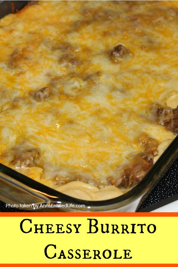 yellow cheese burrito casserole in a serving dish