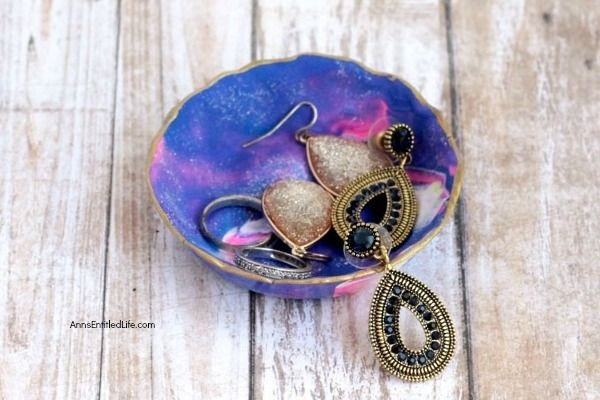 DIY Galaxy Polymer Clay Jewelry Bowl. It is so lovely to see the swirling galaxy colors of pink, purple, and blue. This galaxy clay jewelry bowl turned out amazing, and I look forward to using it every day! Follow these instructions to make your own Galaxy Polymer Clay Jewelry Bowl!
